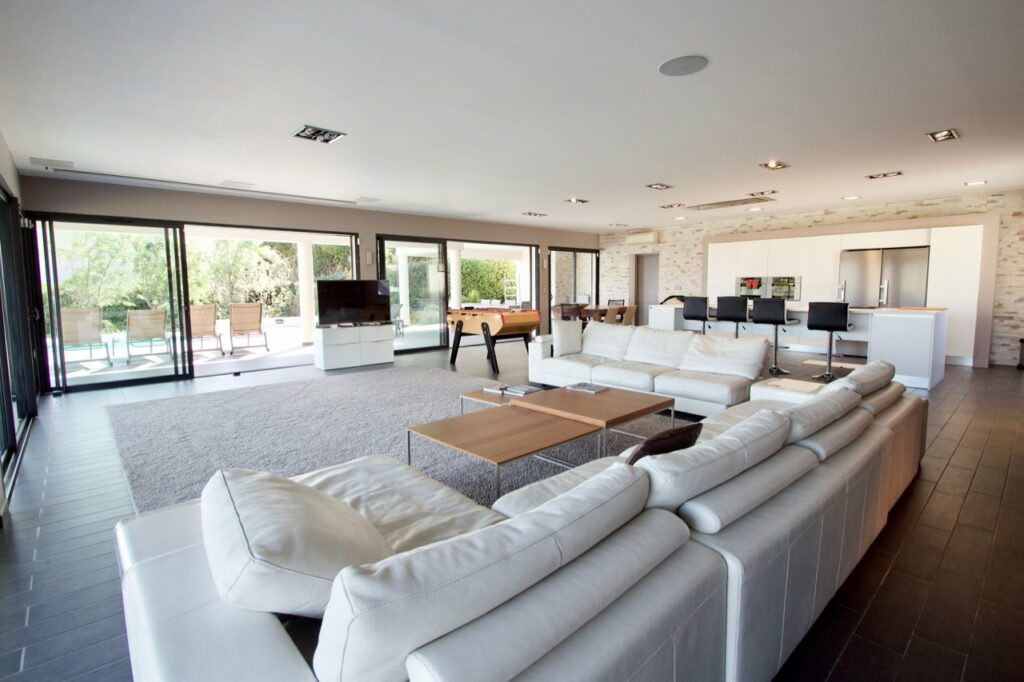 modern living room with white couch and wood floors