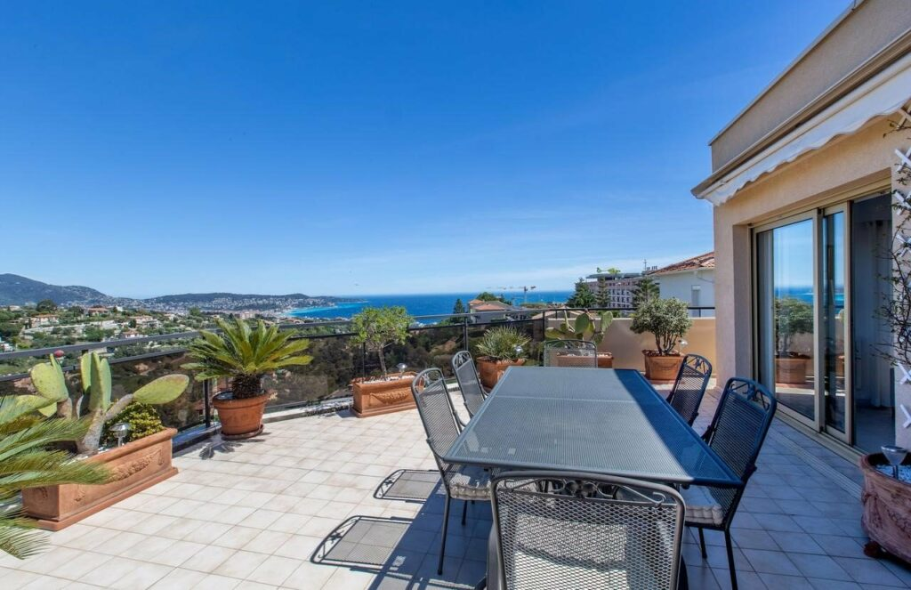 terrace with table and chairs with sea view apartment nice