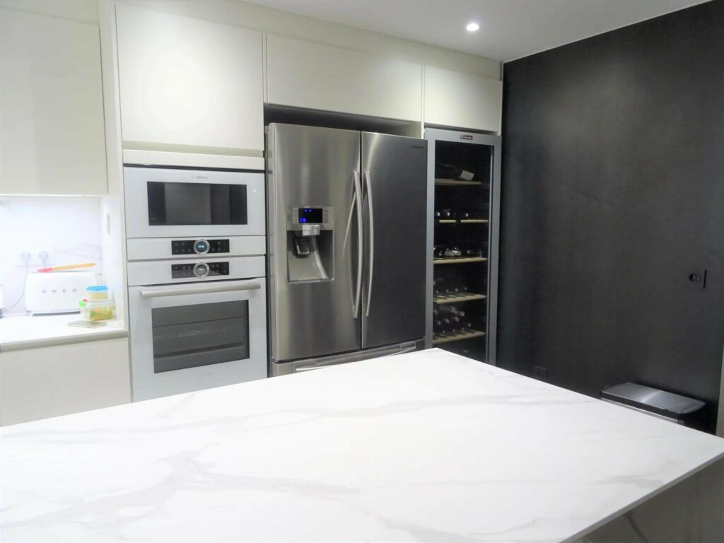 modern kitchen with large white marble island