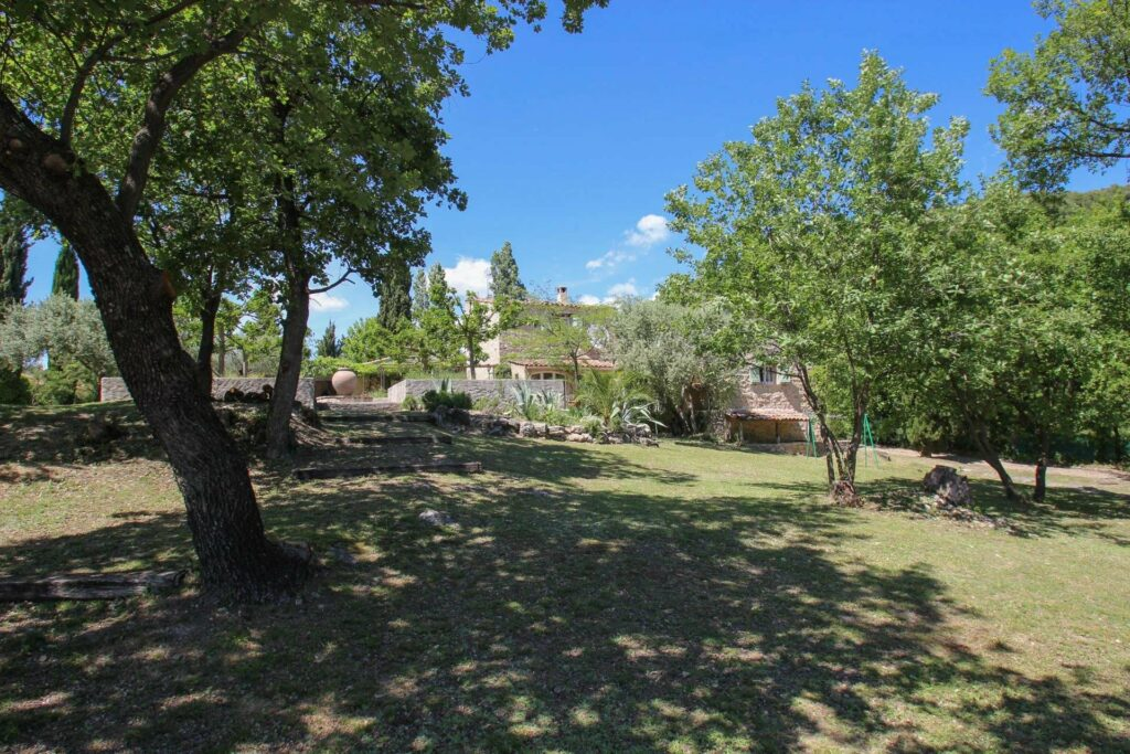 large garden of villa in south france with tall trees