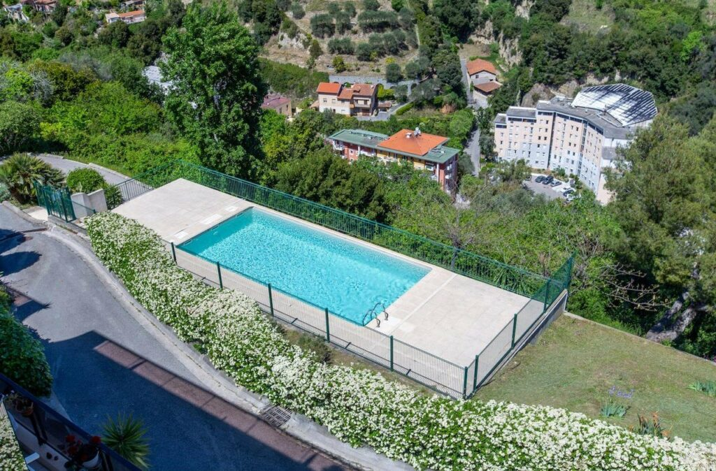 large pool of apartment in nice on a hill overlooking the city