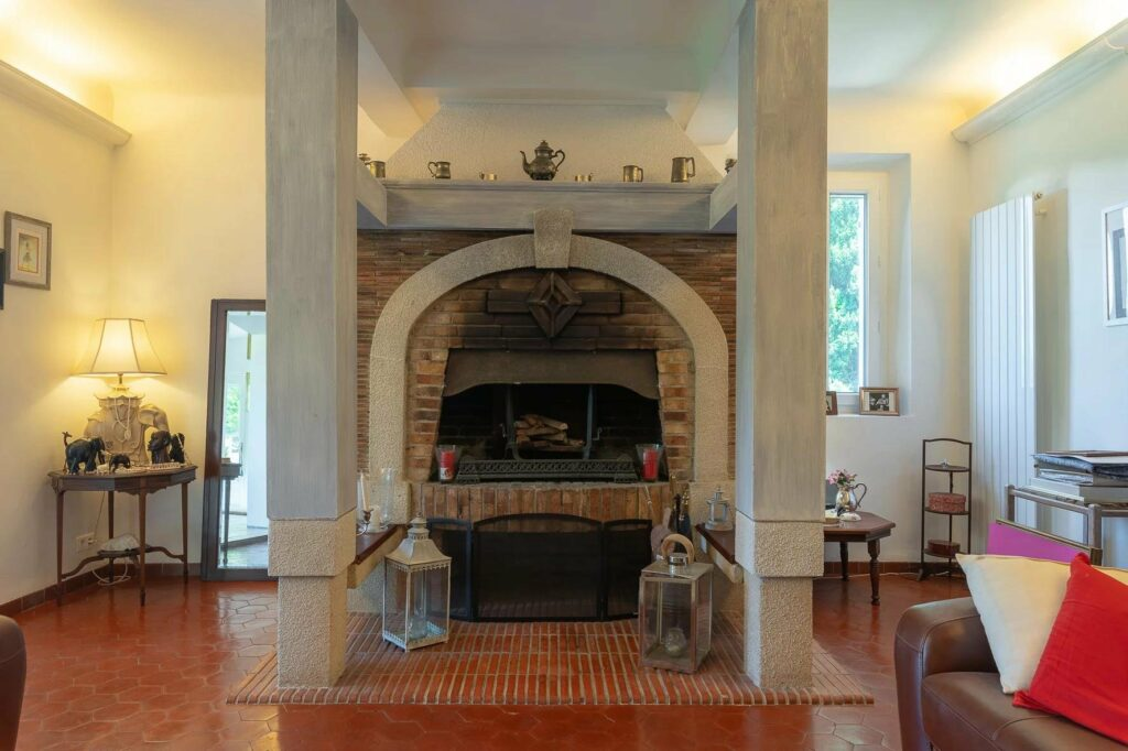 classic fireplace in living room of villa in south france