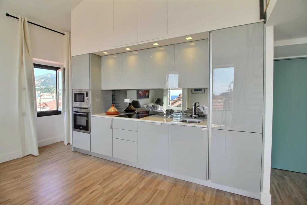 kitchen with white counters and light colored wood floors