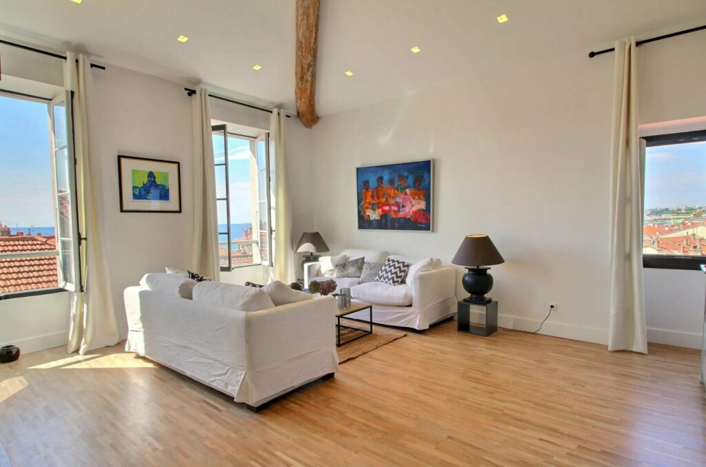 living room at apartment in menton with large french door windows with view