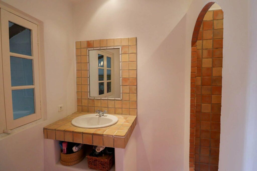 southern french bathrooms with single sink yellow tile and white walls