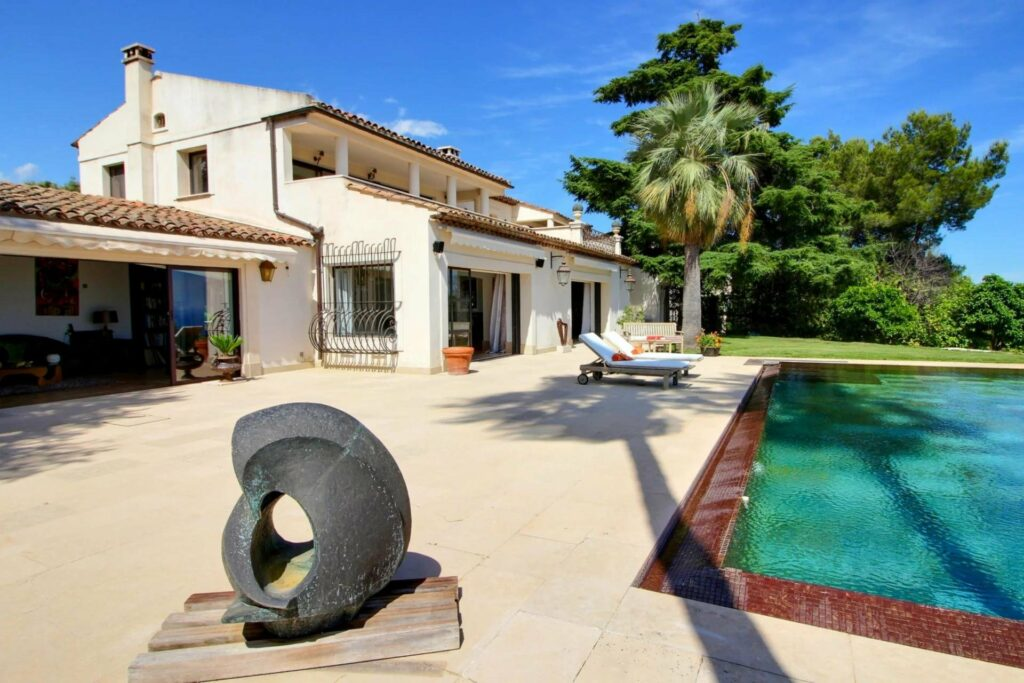 luxury villa with large pool and two floors with beautiful green garden