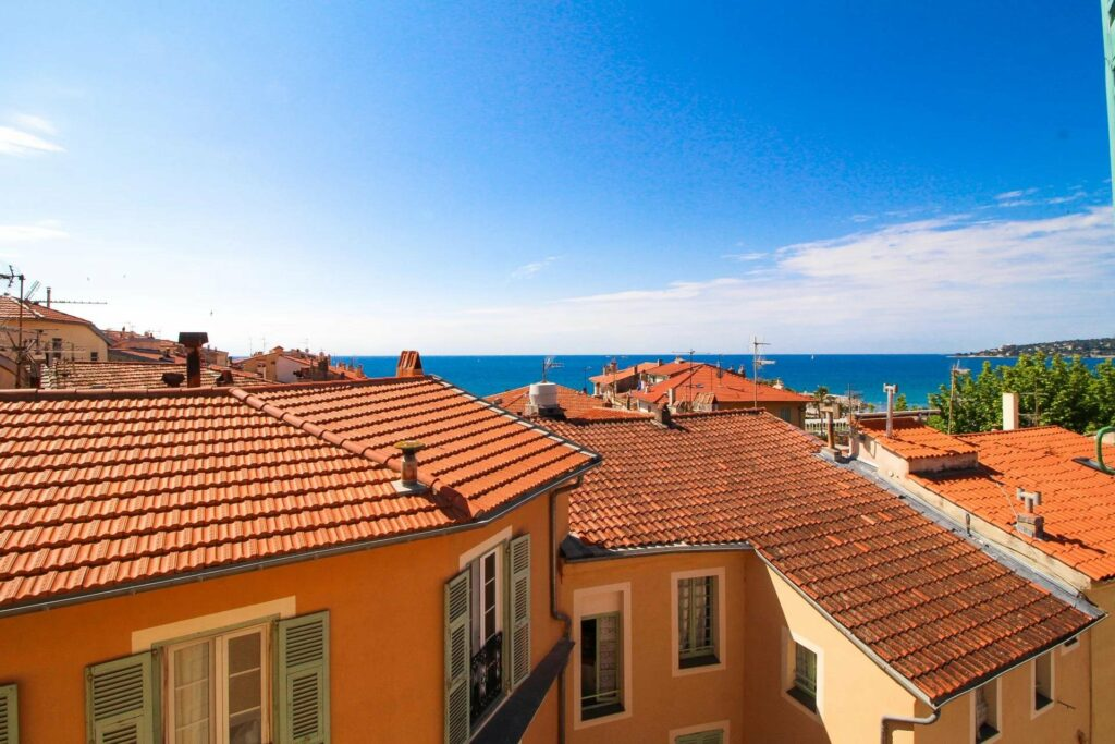 view of french apartment buildings and the south of france mediterranean sea
