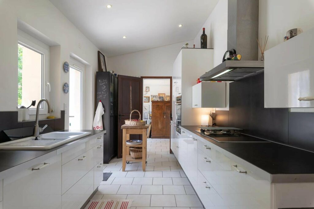 kitchen with white cabinets and white tile floor