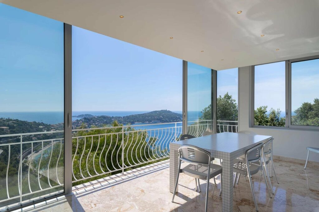 villefranche apartment with floor to ceiling windows and view of the mediterranean sea