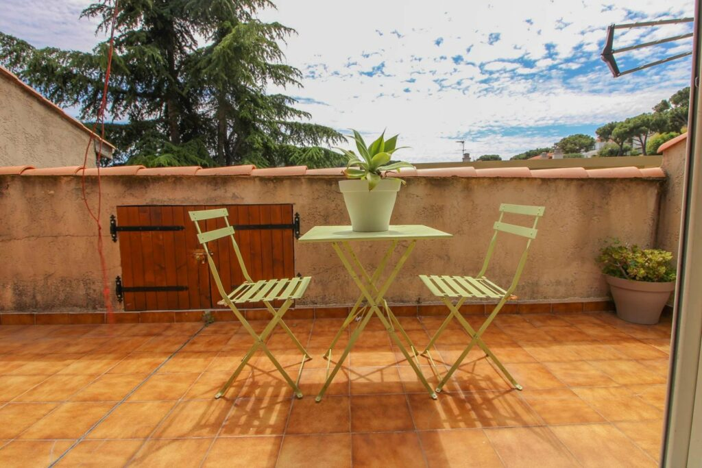 terrace of villefranche house with two light green table and chairs