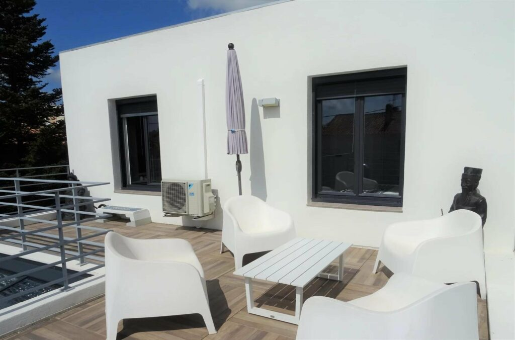 white outdoor seating area with white outdoor furniture