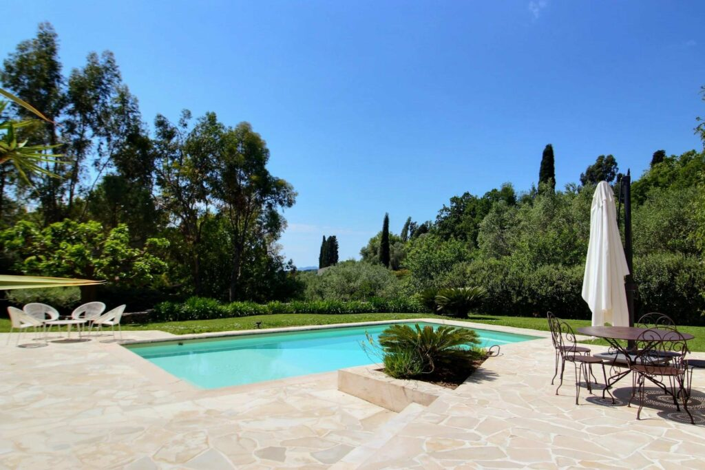 garden of home for sale in south france with private pool and large surrounding trees