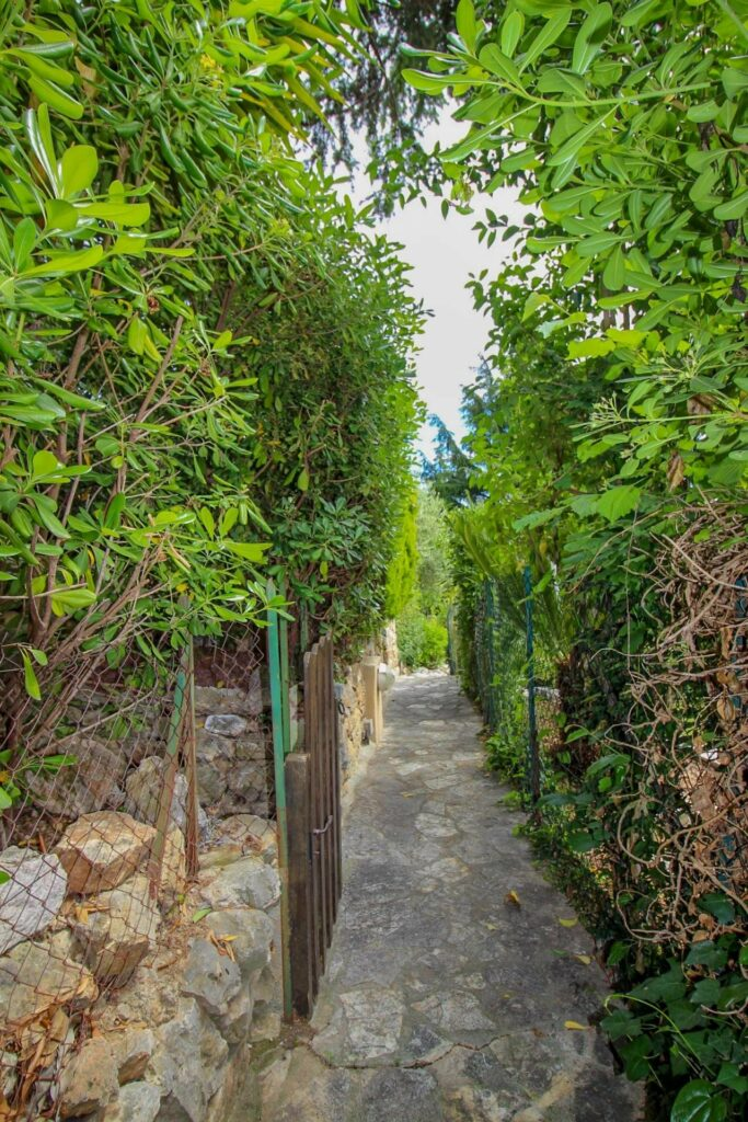 backyard passage area with narrow stone floors