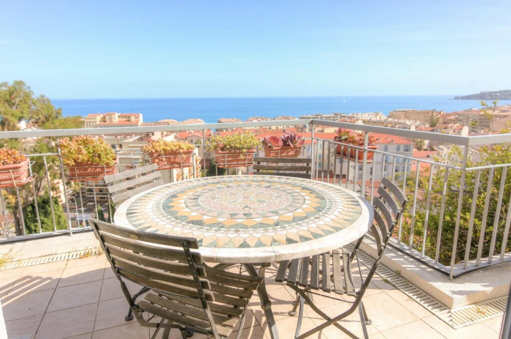 table on terrace of apartment in menton with sea view