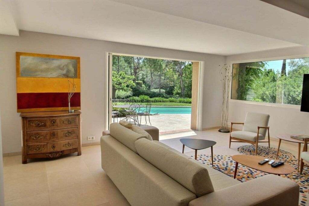 living room of house in south france with cream couch and sliding doors