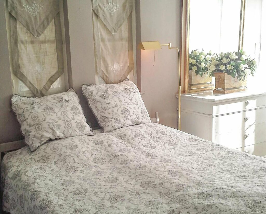 bedroom with flower design bedding with purple accent color in property south france