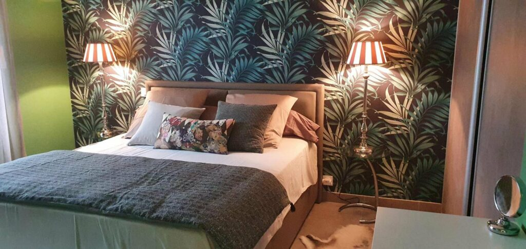 bedroom of frejus contemporary house with green and blue plant wallpaper