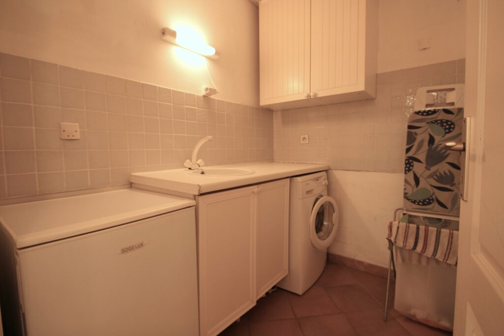laundry room with white cabinets and washer and dryer