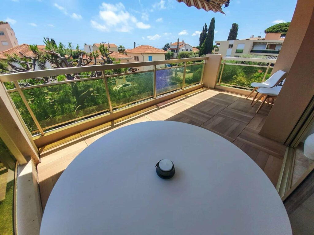 terrace view of neighborhood in south france with round white table