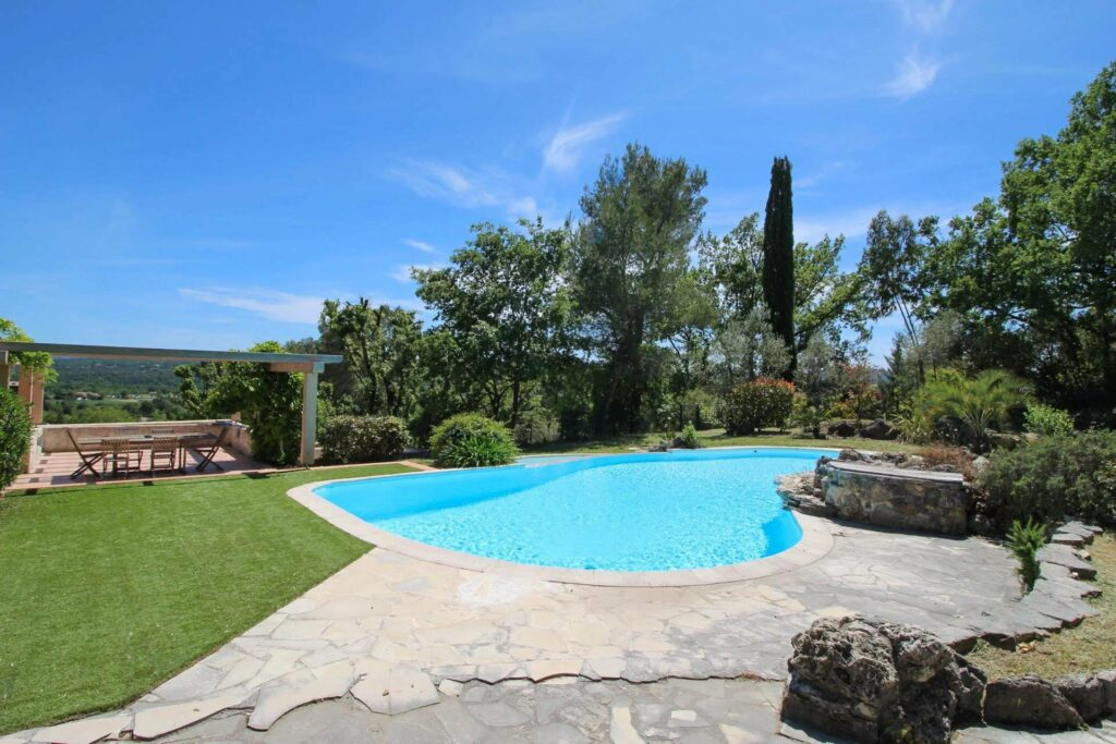 large stone house private pool in south of france with bright blue color and view of mountains
