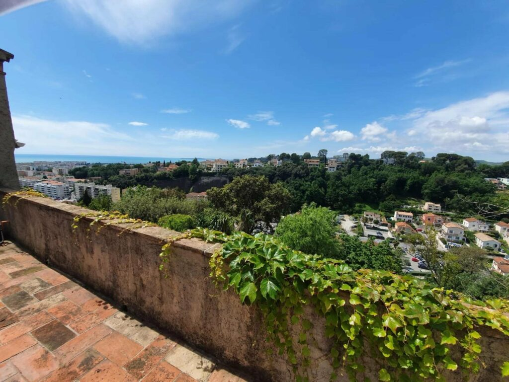 view from stone house in south france with city view and sea view