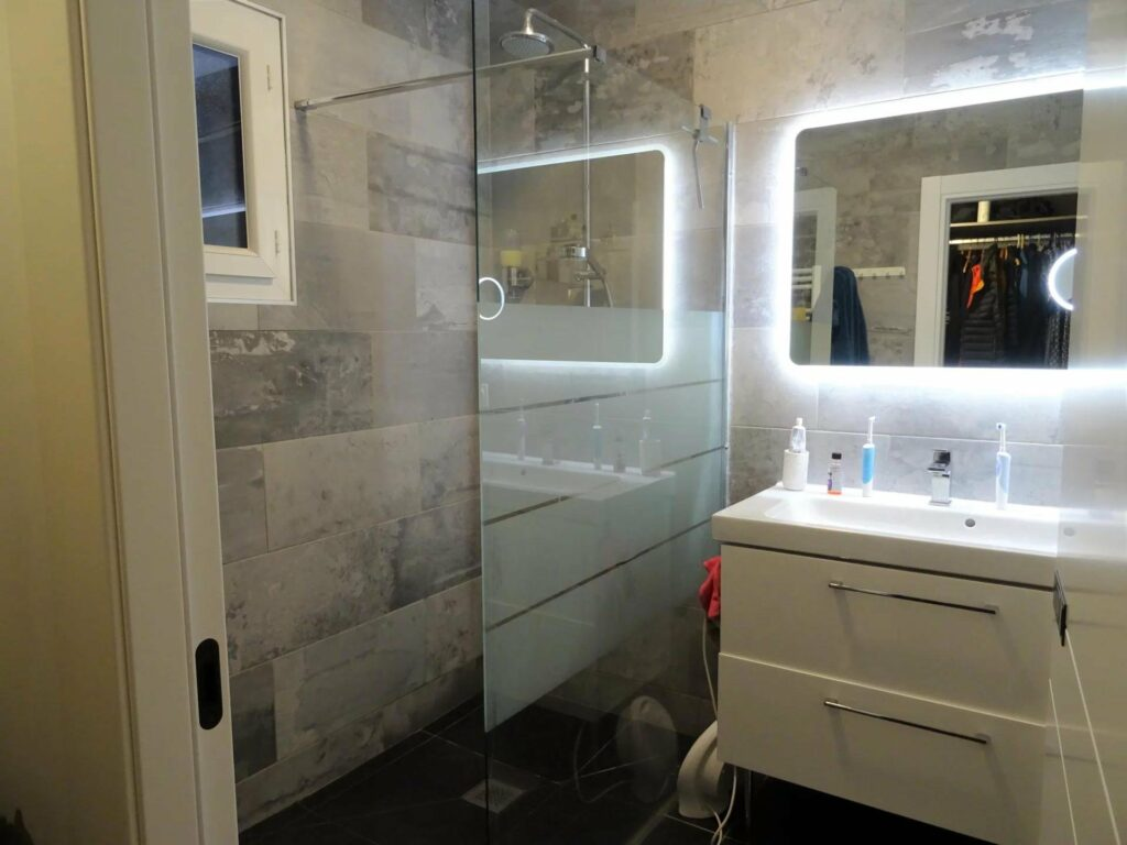 bathroom of contemporary house in opio with minimal design and light up mirror