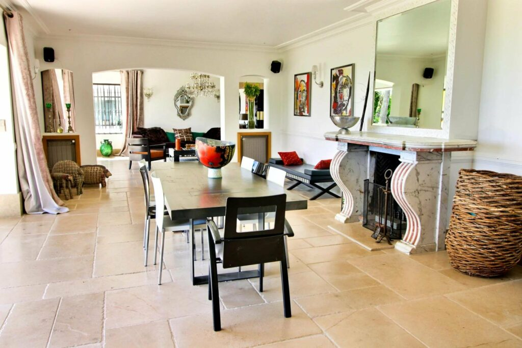 dining area with tile floors and fire place at luxury villa