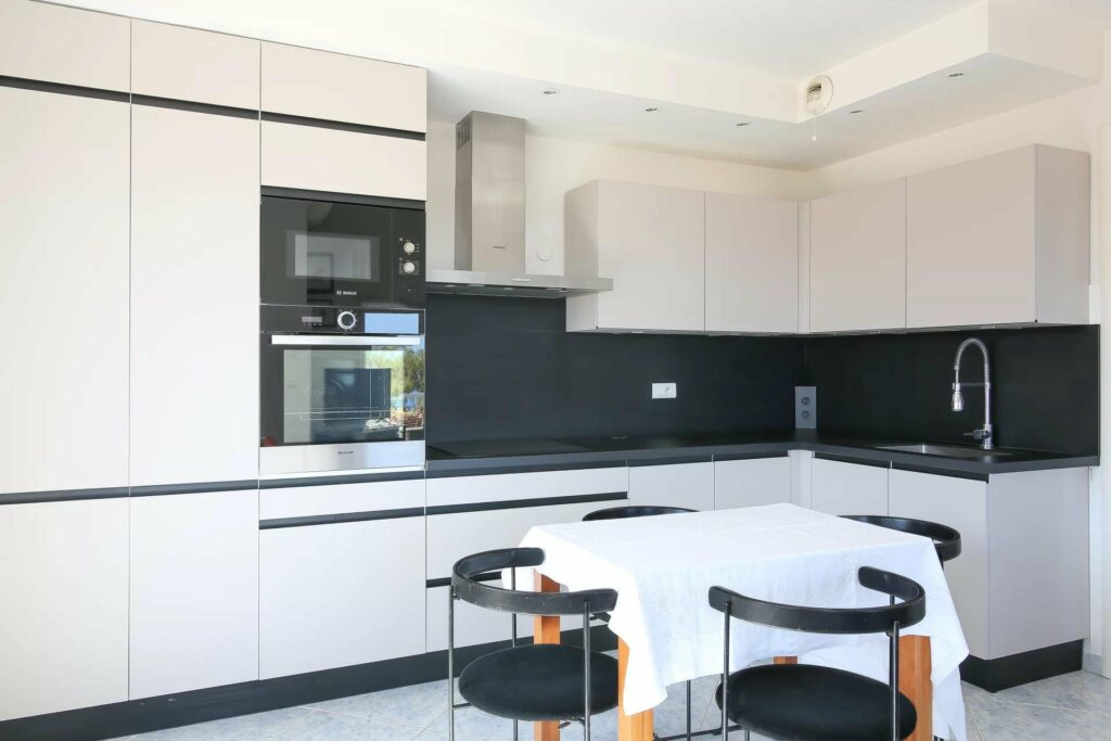 modern design kitchen with black walls and white counters