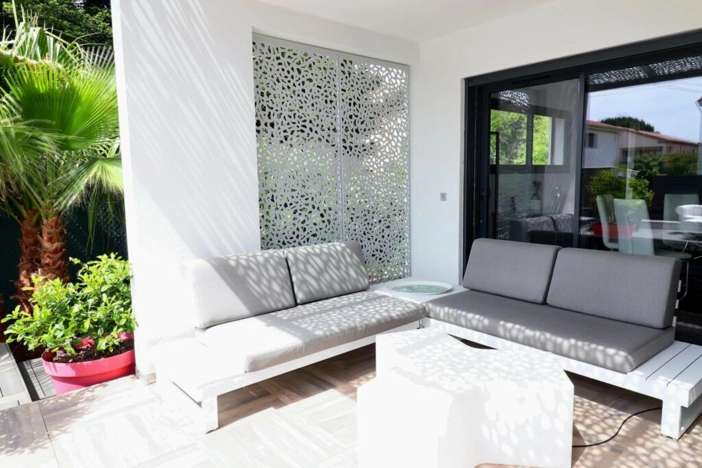 outdoor seating area with grey colored couch