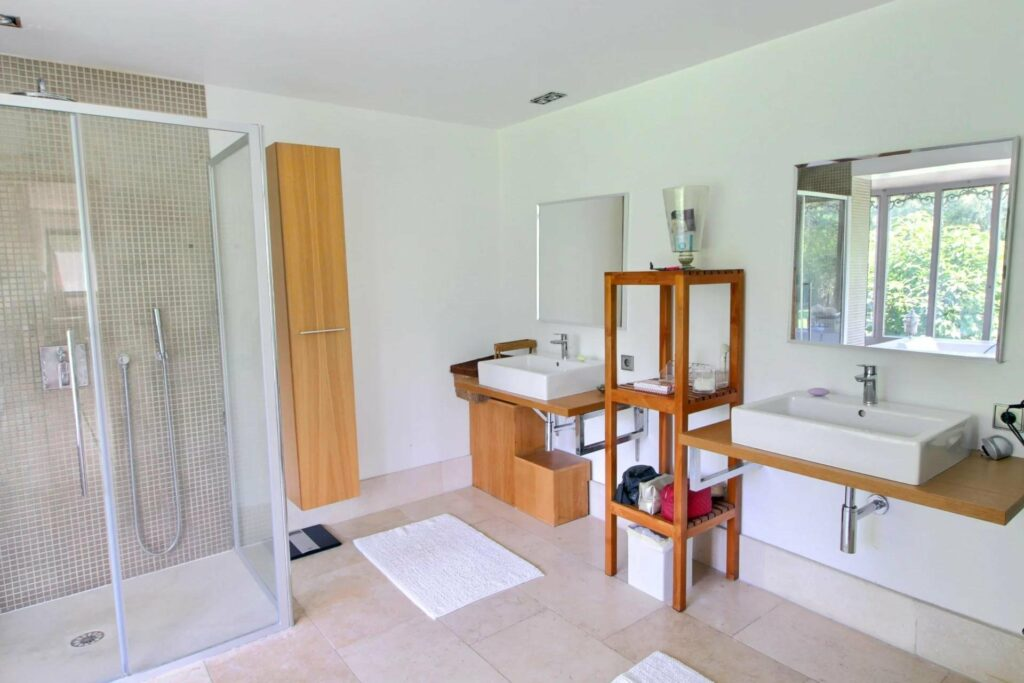 bathroom with with tile floors and light wood accent features