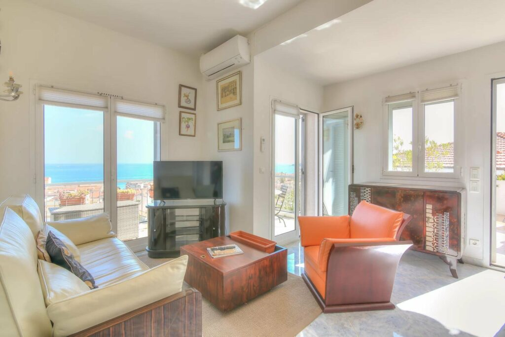 living room in apartment with large windows and sea view