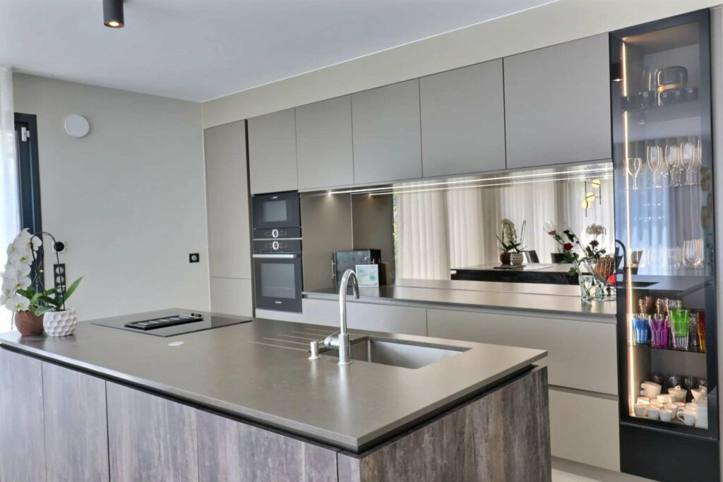 kitchen of apartment with modern design and grey island