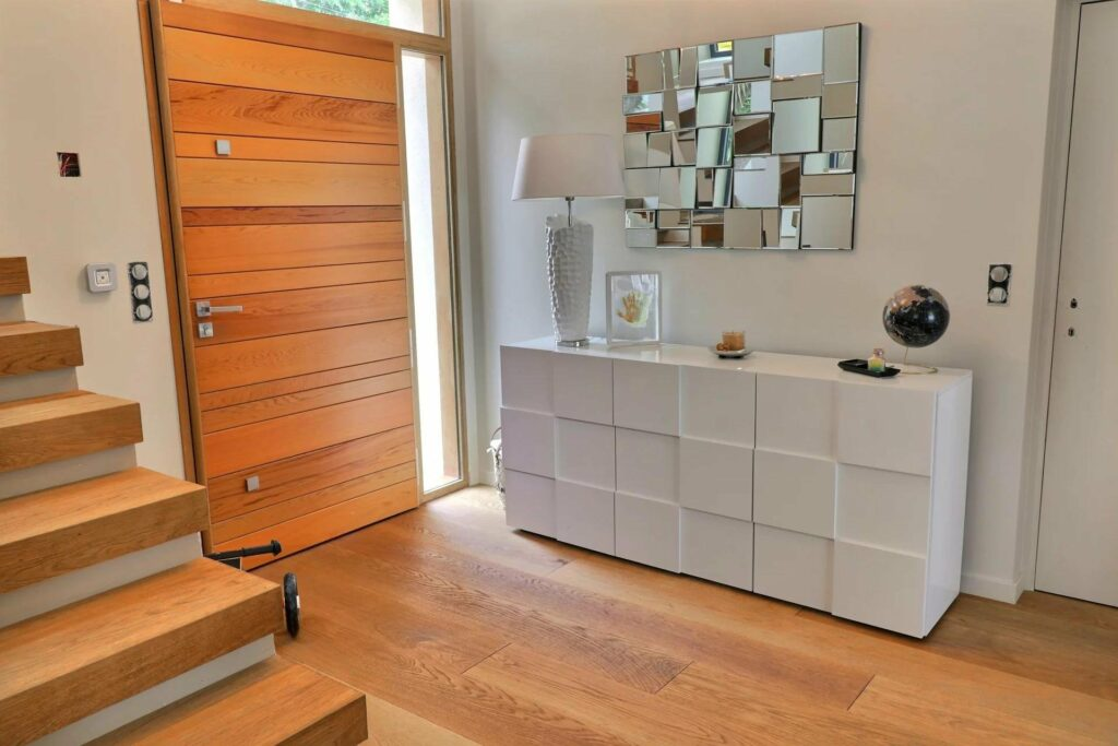 entrance to apartment for sale in antibes with light wood door and floors