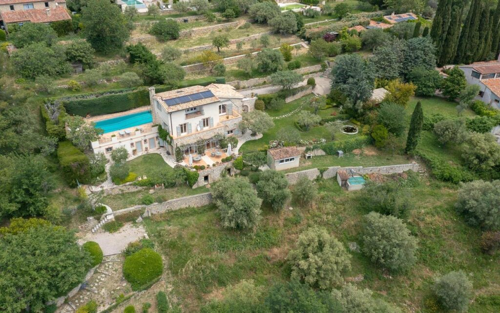 birds eye view of villa in south france with huge plot of land and long rectangular pool