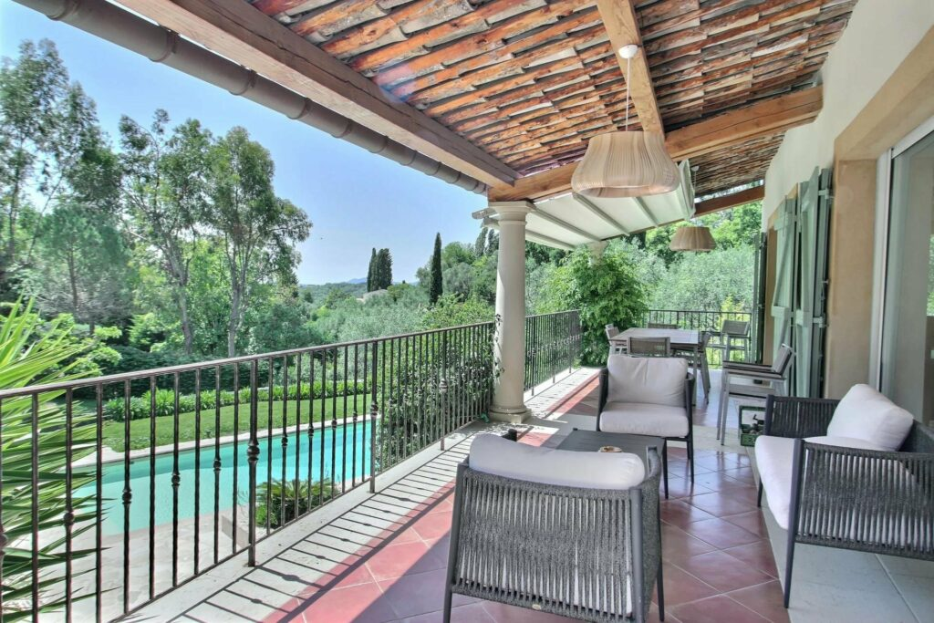 terrace of house in opio with outdoor furniture facing pool