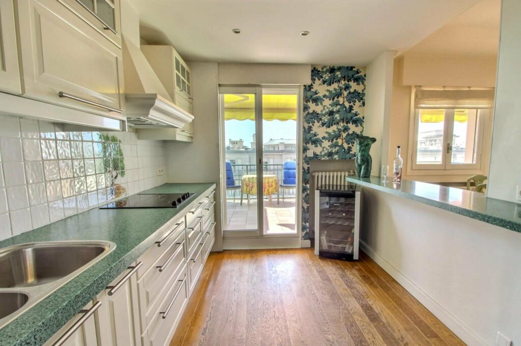kitchen with wooden floors glass sliding door access to terrace