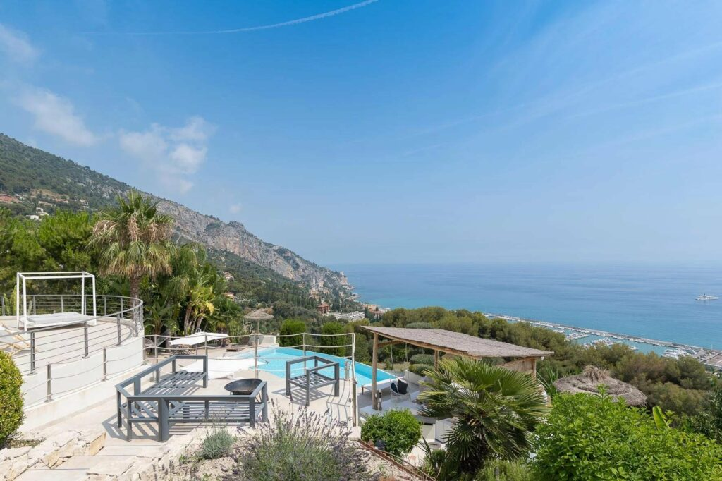 backyard with sea view of luxury villa property with guest house