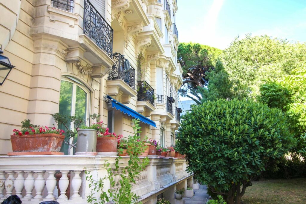 beautiful french style apartment building with light yellow walls and bay windows
