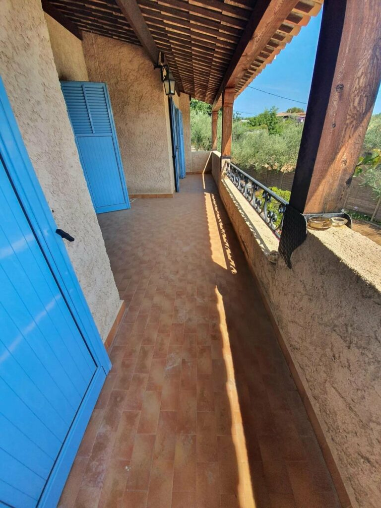 terrace of house near vence with blue doors and stone design