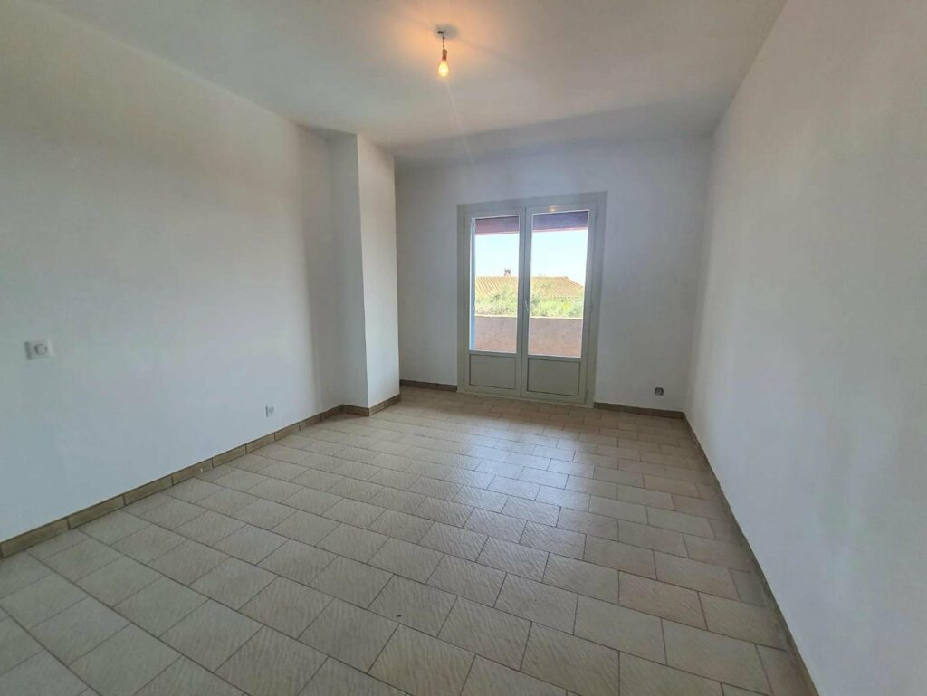 bedroom of two floor house near nice with light wooden floors with french door access to terrace