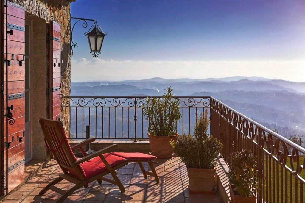 terrace of villa in grasse with panoramic view over the french riviera with red lay out chair