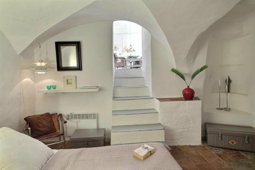 white stairs leading down to bedroom