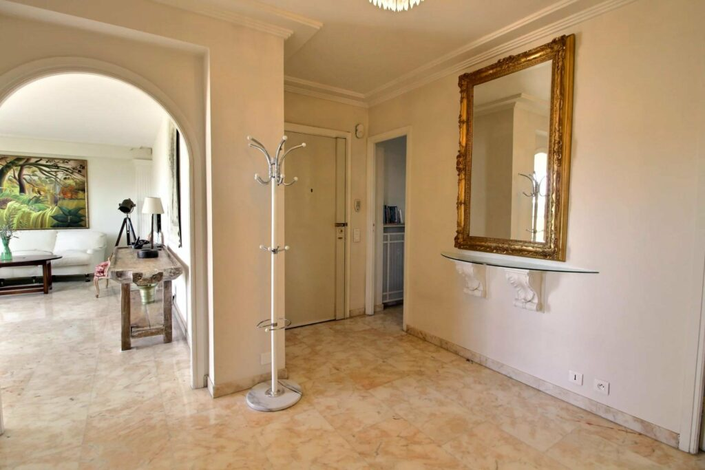 apartment hallway with large square mirror
