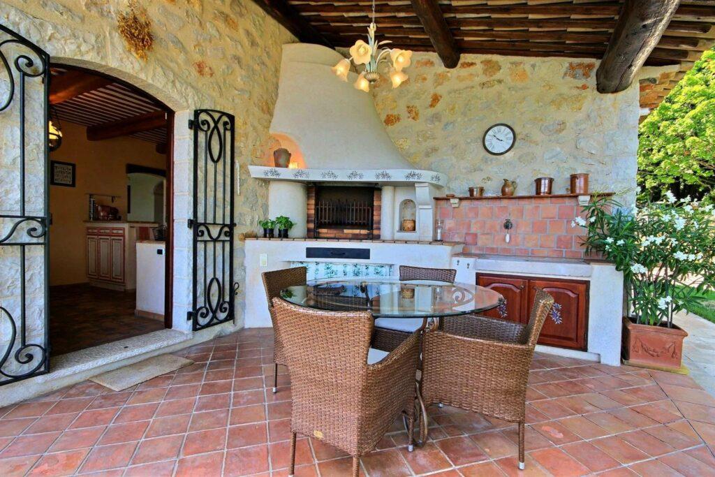 backyard area with outdoor kitchen in grasse villa