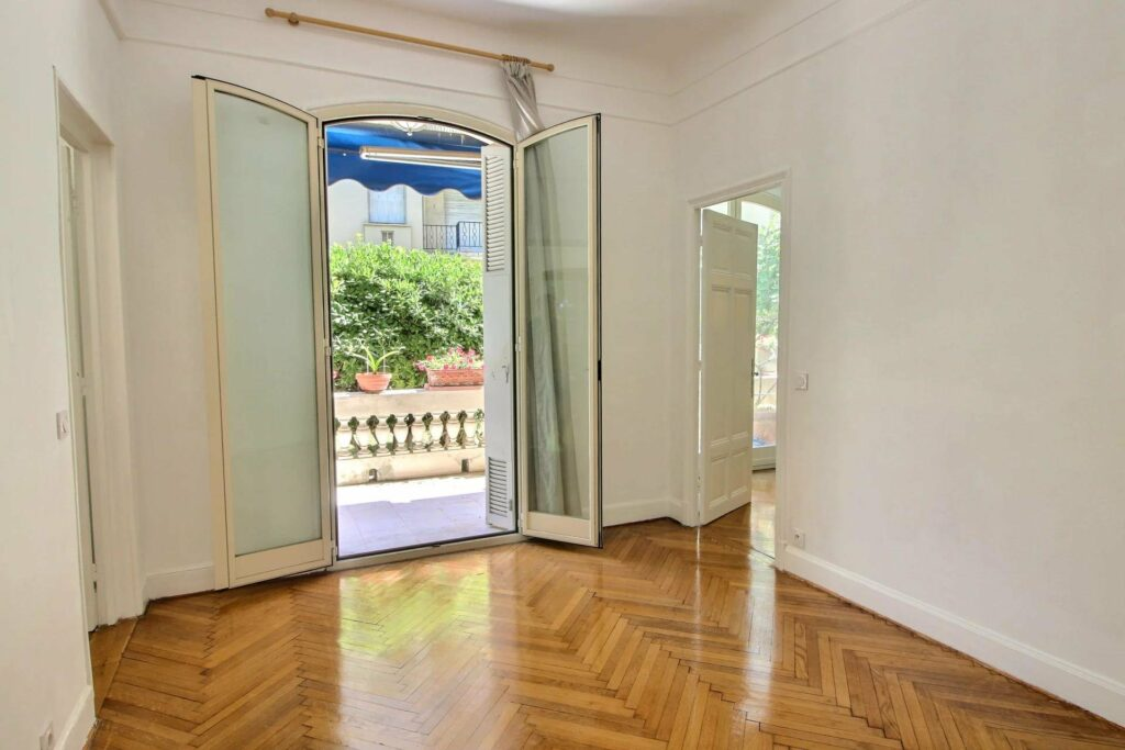 bedroom with large french doors to balcony of apartment in nice