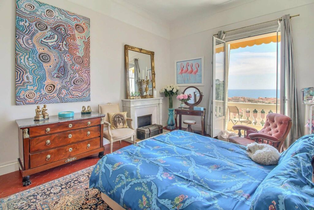 bedroom at apartment in menton with blue bedding