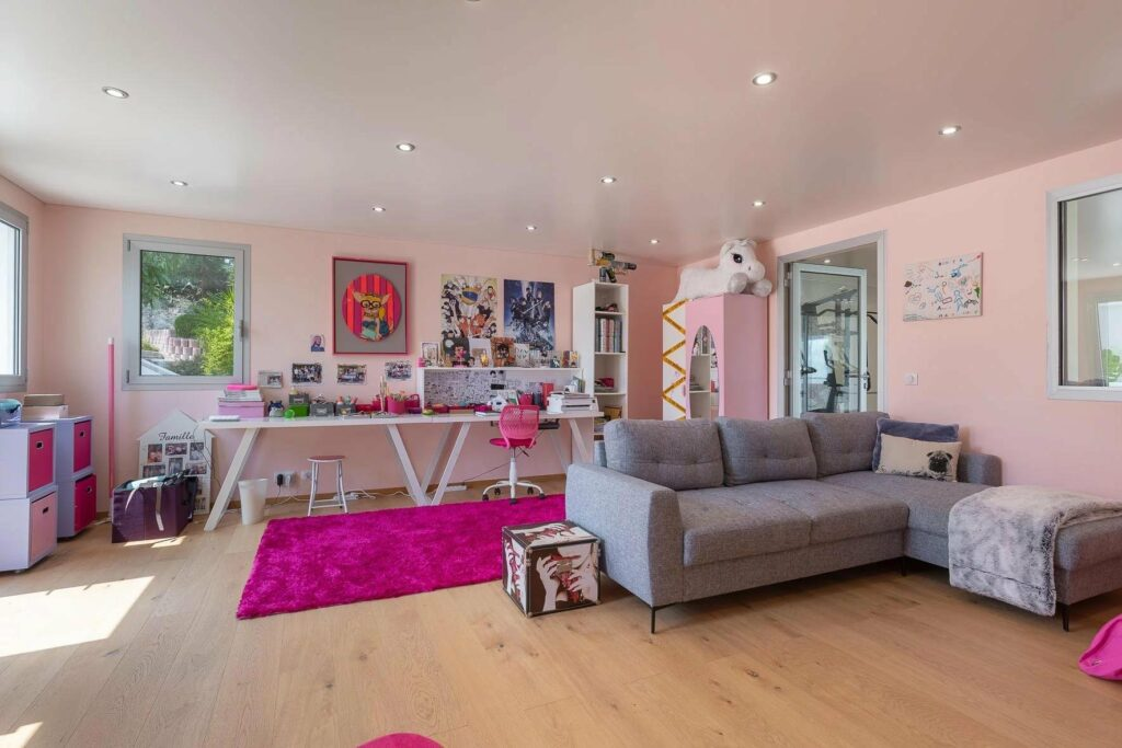 bedroom with pink theme and light wood floors in luxury france villa