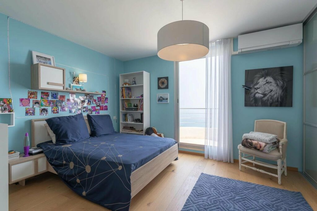 bedroom with modern blue theme and sea view
