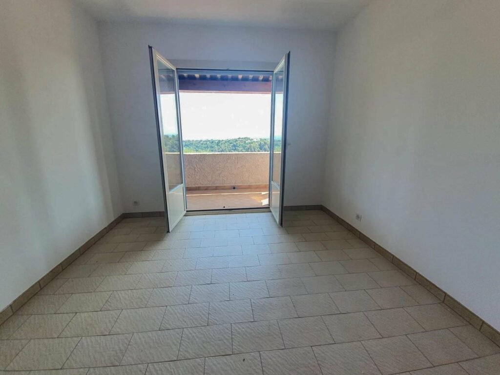 bedroom of house near nice for sale wih white tile floors and open terrace doors with access to terrace