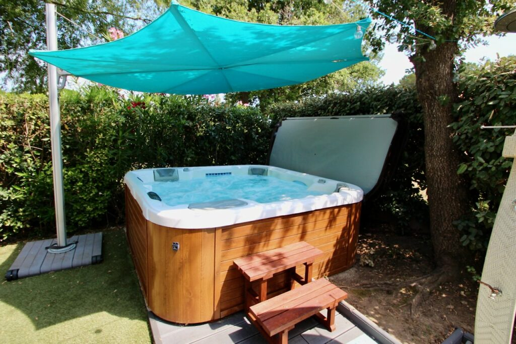 small jacuzzi in backyard of french home